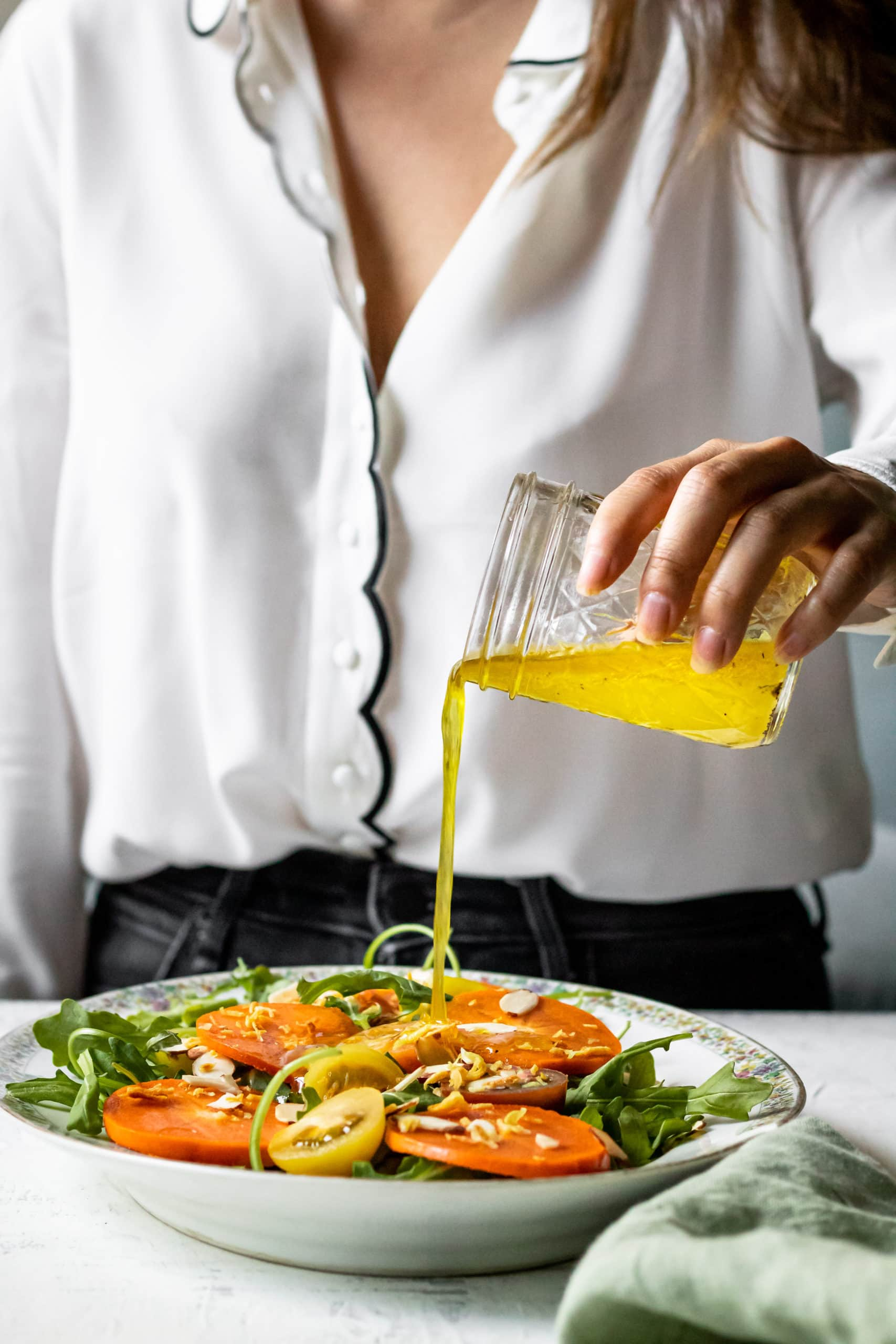 pouring salad dressing