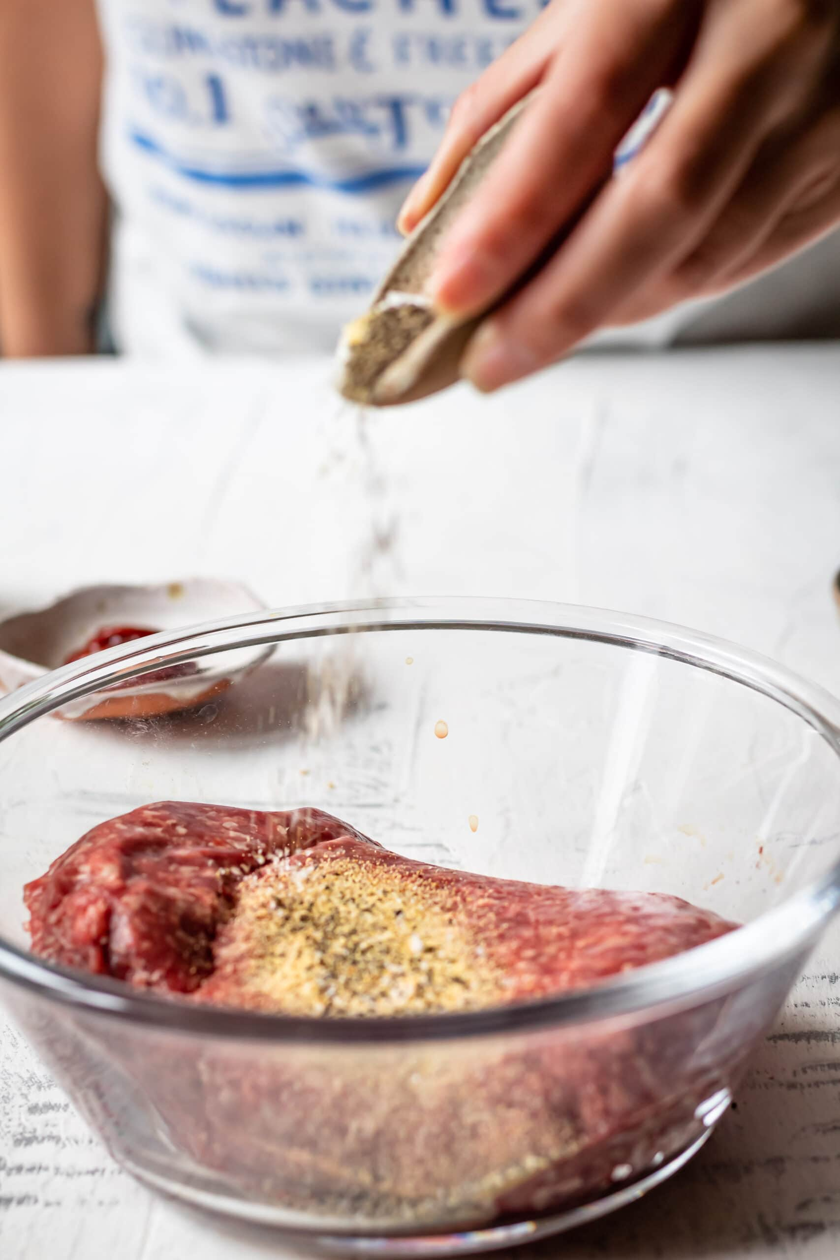 seasoning the hamburger meat