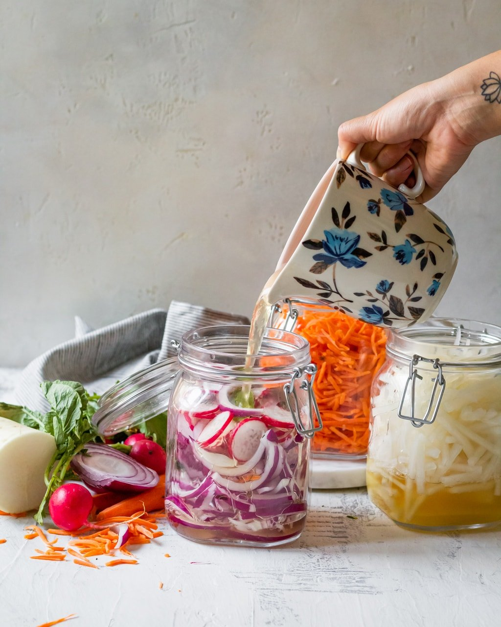 pouring pickling liquid over the vegetables