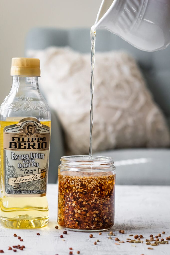 Pouring oil over chili flakes